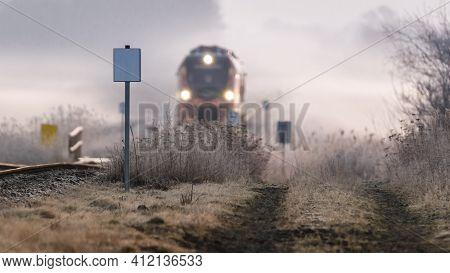 Foggy Morning - Railway Track And Running Regional Train