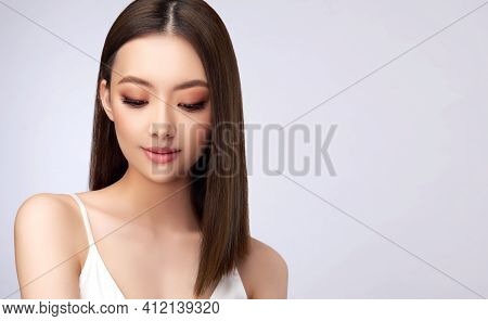Beautiful Asian Woman With  Straight Hair. Beauty Chinese  Girl With Clean And White Skin. Fashion,