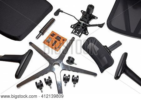 Components Of An Office Chair. Closeup Of A Complete Set Of Spare Parts For Assembly Of An Computer