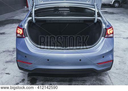 Novosibirsk, Russia - March 2 2021: Hyundai Solaris, Rear View Of A Car With An Open Trunk. Exterior