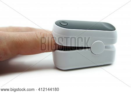 Pulse Oximeter Isolated On White Background. Pulse Oximeter Used To Measure Pulse Rate And Oxygen Le