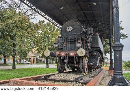 Old Steam Locomotive On A Pedestal
