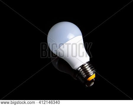 White Led Lamp On A Black Background. White Led Lamp. Black Background. Electric Lighting. Electrica