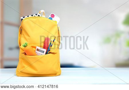 Yellow Backpack With School Supplies On Wooden Table Empty Copy Space Background.knapsack With Tools