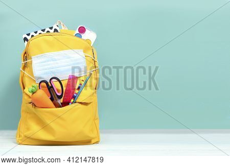 Yellow Backpack With School Supplies And Face Protective Masl.back To School,knapsack With Accessori