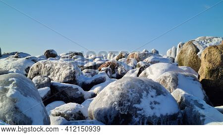 Pile Of Snowy Rocks In The Winter Mountains On A Sunny Winter Day With A Blue Sky. Winter Landscape