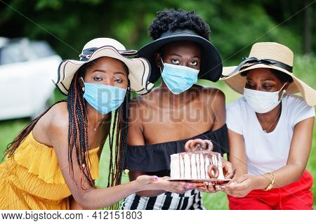 Group Of African American Girls With Facial Masks Celebrating Birthday Party Outdoor With Decor Duri