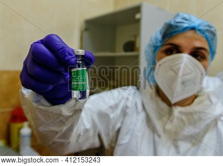 Uzhgorod, Ukraine - March 11, 2021: A Doctor Prepares A Vaccine Covishield Against Coronavirus Infec