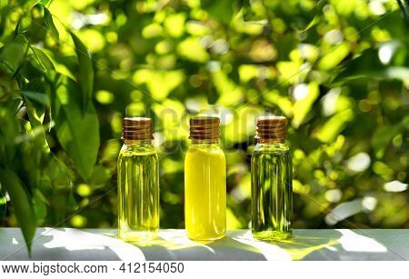 Cosmetic Display On Green Leaves And Natural Stone Backdrop. Natural Cosmetics And Beauty Concept. C
