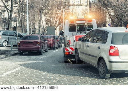Car Evacuation Police Service By Tow Truck Machine On City Downtown Street Center Due Parking Traffi