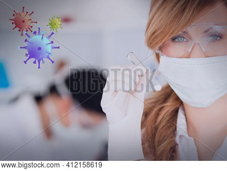 Covid-19 cells against portrait of female health worker wearing face mask holding a test tube. coronavirus covid-19 pandemic concept