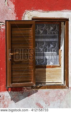 Open Decorated Window With Shutter. Burano Island, Venice, Italy