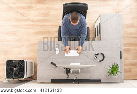 Online Home Office Worker In Front Of Computer Top View. Caucasian Men In His 40s And His Workstatio