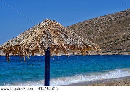 A Beach Umbrella At The Sandy Beach Of Ios Cyclades Greece