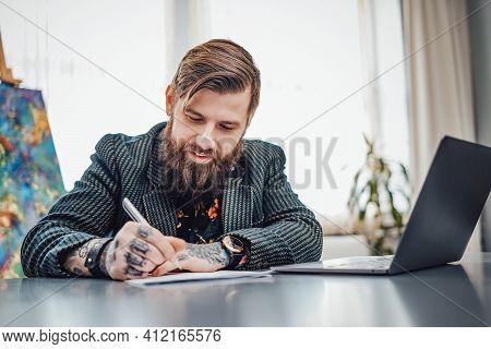 Atmospheric Portrait Of A Adult Computer Programmer With Tattoos And Wearing Stylish Clothing. Joyfu