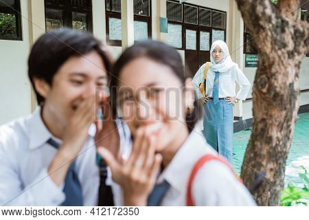 Angry Veiled Girl Stand When A Boy Whispered To A Girl In High School Uniform