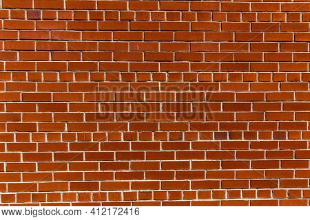 Red brick wall with contrasty sunlight