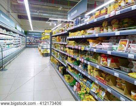 St. Petersburg, Russia - January 12, 2021: Rows Of Shelves With Fast Food Products In Supermarket. R