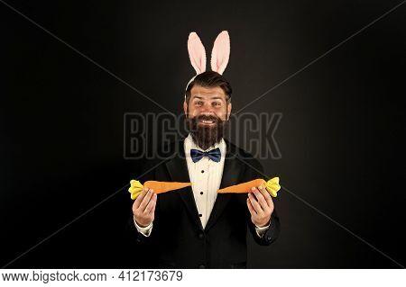 Spring Vitamin Deficiency. Happy Businessman Hold Vitamin Carrots. Easter Rabbit Enjoy Eating Vitami