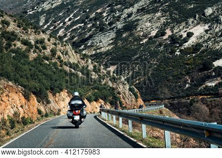 Motorbikers On Mountain Road. Driving A Empty Road
