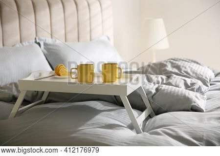 Soft Blanket And Tray With Breakfast On Bed Indoors