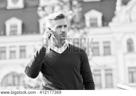 Holding Conversation By Telephone. Handsome Man Have Phone Conversation. Business Conversation. Answ
