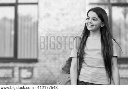 Happy Teen Carry Backpack. Smiling Kid In Schoolyard. Childhood Happiness. Girl Ready For Lesson. Ge