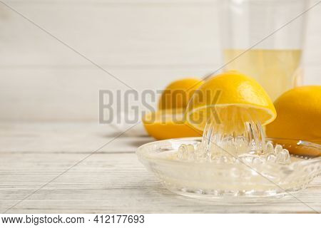 Freshly Squeezed Lemon Juice On White Wooden Table. Space For Text