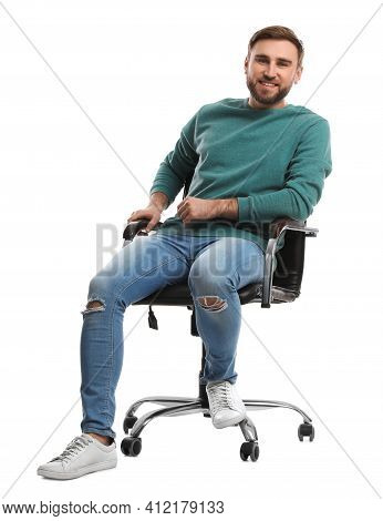Young Man Sitting In Comfortable Office Chair On White Background