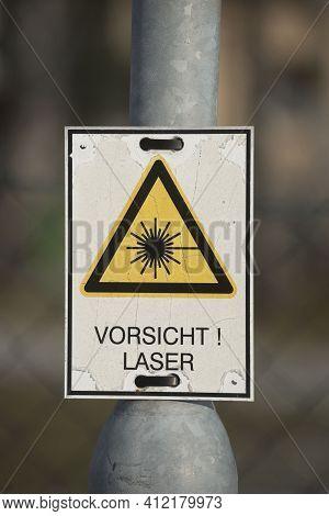 A Caution Laser Sign In German (vorsicht Laser), Laser Technology In Science