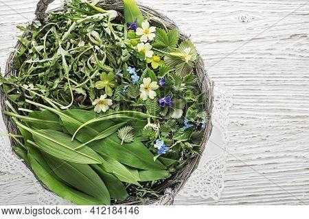 Healthy Spring Food Ingredients. Dandelion, Wild Garlic And Nettle In Basket