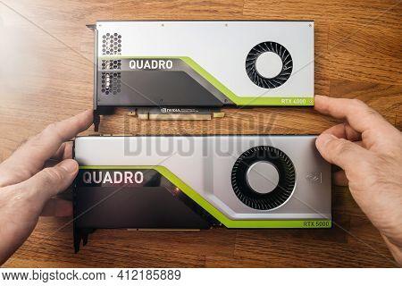 Paris, France - Mar 28, 2019: Senior Engineer Hands Pov Holding Looking Comparing Two New Gpu Nvidia
