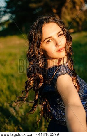 Party Graduation Prom Fairytale Concept. Beautiful Brunette Young Woman In Blue Prom Dress On Nature