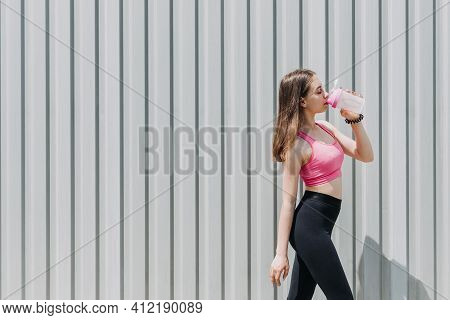 Sports And Hydration, Drink Water, Stay Hydrated During Exercise. Fitness Young Woman, Teen Girl Dri