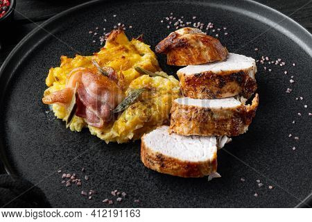 Grilled Pork Fillet And Mash Potatoe Gratin With Sage And Prosciutto Set, On Plate Dish, On Black Wo