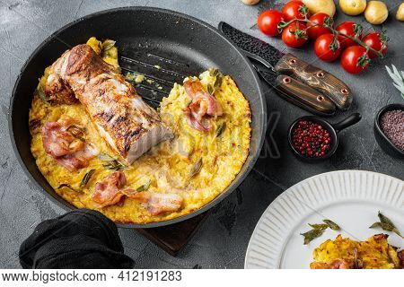 Grilled Pork Fillet And Mash Potatoe Gratin With Sage And Prosciutto Set, On Frying Cast Iron Pan An