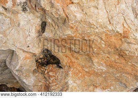Light Red-orange Stone Texture. Red Orange Grunge Background. Mountain Texture Macro Close-up. Brigh