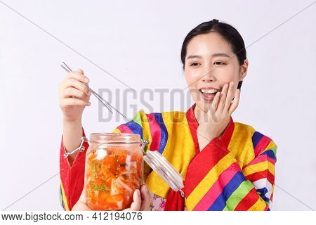 Beautiful Korean Woman Wearing Hanbok Holding Chopsticks Pick Up Kimchi In A Glass Jar Ingredients I