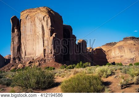 Cliff Face Of Spearhead Mesa Rock Formation In Monument Valley Tribal Park In Arizona, United States