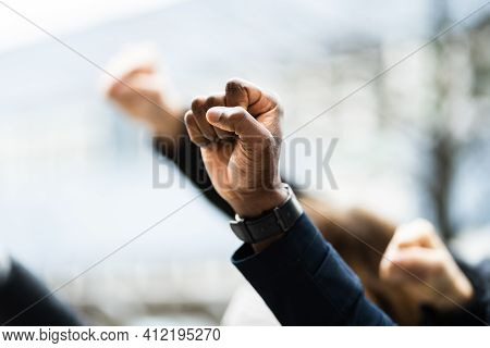 Protesting Raised Activist Fist At Demonstration March