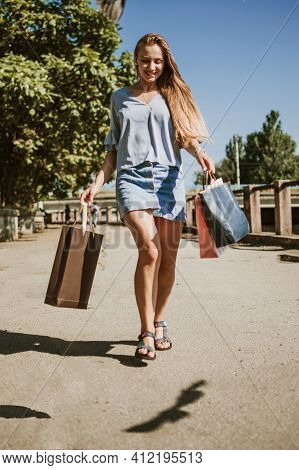 Spring Summer Sale, Enjoys Shopping, Consumerism. Happy Young Woman With Many Shopping Bags Enjoying