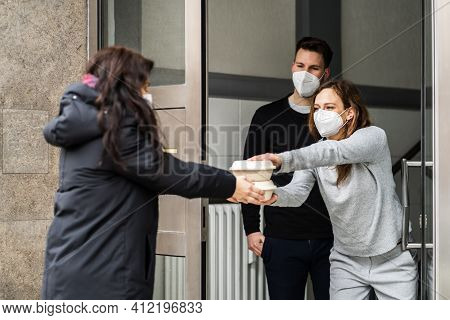 Neighbor Giving Rescue Food Help In Face Mask