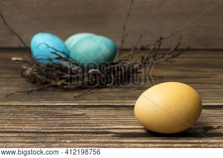 Easter Background With Easter Eggs Nest And Twigs On A Painted Wooden Background. Happy Easter. Cong