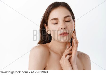 Beauty Face. Smiling Woman Touching Healthy Skin Portrait. Beautiful Happy Girl Model With Fresh Glo