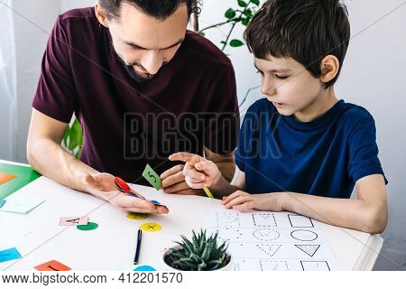 Autism Awareness Concept. Autism Schoolboy During Therapy At Home With His Tutor With Learning And H