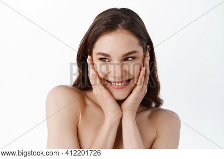 Skincare And Beauty. Girl With Nourished And Clean Skin Touching Her Clean Hydrated Face, Smiling An
