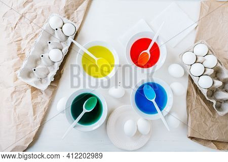 Flat Lay Preparing For Easter With Liquid Food Coloring. Different Colors In Different Bowls, Egds O