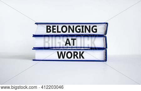 Belonging At Work Symbol. Books With Words 'belonging At Work' On Beautiful White Background. Busine