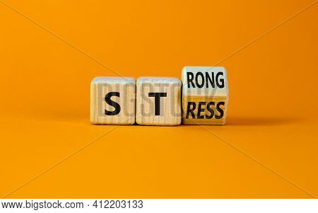 Strong Stress Symbol. Turned Wooden Cubes With Words 'strong Stress'. Beautiful Orange Background, C