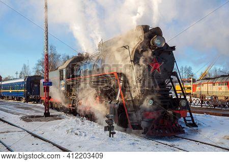 Sortavala, Russia - March 10, 2021: Tourist Retro Train On Steam Locomotive Departs From Sortavala S